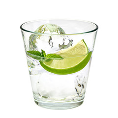 Vodka lime, gin tonic, mojito or Caipirinha cocktail with lime wedge isolated on white background