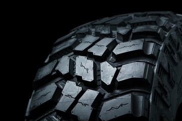 New Car Tires on black  background