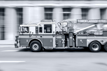 fire trucks and firefighters brigade in the city in monochrome blue tonality