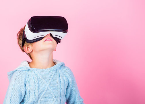 Explore alternative reality. Cyber space and virtual gaming. Virtual reality future technology. Discover virtual reality. Kid boy wear vr glasses pink background. Child boy play virtual reality game