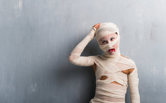 Boy in mummy costume for halloween holidays