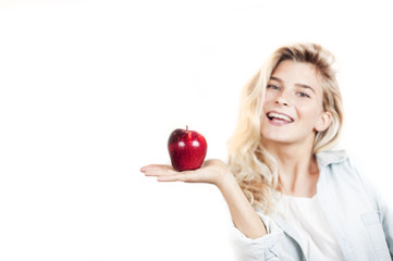 Very beautiful young bright girl holding a red apple in her hands on a white background