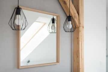 Mirror and lamps in bathroom