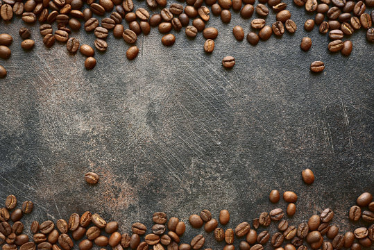 Food background with roasted black coffee beans.Top view with copy space.