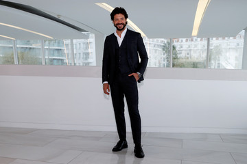 "Alvaro Morte poses during a photocall for the television series "" The Pier"" during the annual MIPCOM television programme market in Cannes"