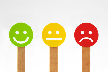 Green, yellow and red smiley faces with positive, neutral and negative expression