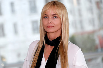 "Izabella Scorupco poses during a photocall for the television series ""Hidden: Forstfodd"" during the annual MIPCOM television programme market in Cannes"