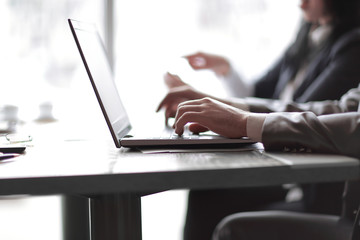 close up.businessman working on a laptop sitting at his Desk