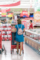 Young woman in supermarket on Bali island.