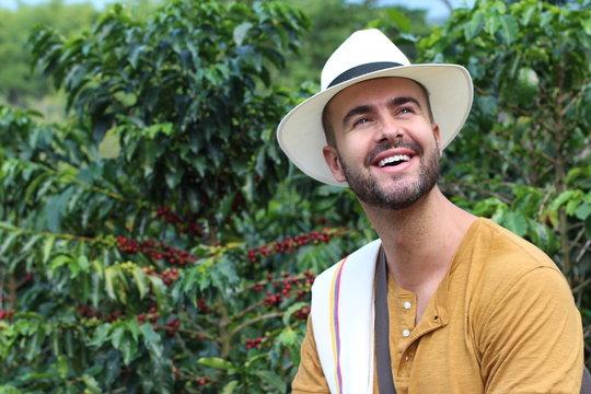 Handsome farmer in coffee plantation