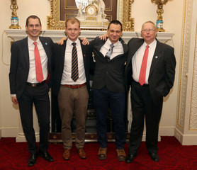 Cave divers Chris Jewell, Connor Roe, Jim Warny and Rob Harper who took part in the successful search and rescue of 12 boys and their football coach from the Tham Luang Cave in Thailand, pose for a picture during a reception hosted by Prince William at Buc