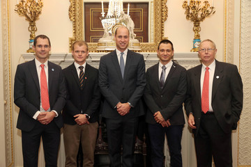 Britain's Prince William poses with cave divers Chris Jewell, Connor Roe, Jim Warny and Rob Harper who took part in the successful search and rescue of 12 boys and their football coach from the Tham Luang Cave in Thailand, during a reception in London