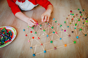 child making geometric shapes, engineering and STEM education