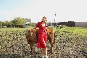 girl in red dress with a dangerous bull