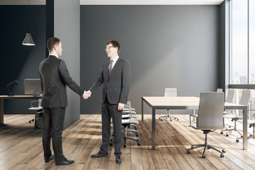Attractive businessmen shaking hands