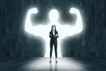 Businesswoman with muscly arms