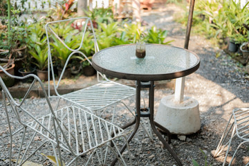 Table and chairs in the garden.