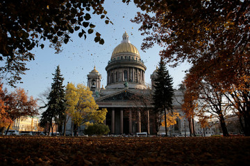Autumnal trees of the Alexander Garden are pictured in front of Saint Isaac's Cathedral in St. Petersburg