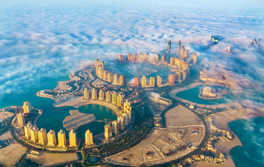 Foto op Canvas Asia land Aerial view of the Pearl-Qatar island in Doha through the morning fog - Qatar, the Persian Gulf