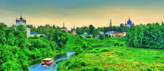 Suzdal town over the Kamenka river in Russia