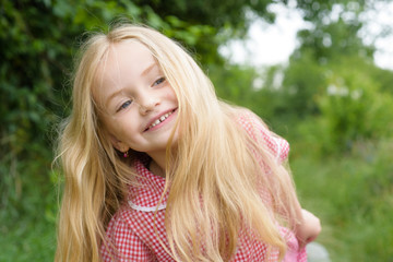 Happy with the simple things. Little girl wear long hair. Small girl with blond hair. Happy little child with adorable smile. Small child happy smiling. Long and healthy hair