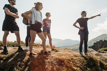 a group of people go to a hike in the mountains