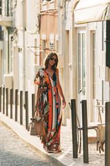 Stylish woman with handbag on street