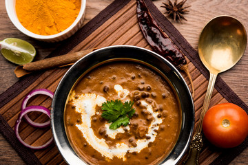Dal makhani / makhni is a popular dish from India. Made with ingredients like whole black lentil, butter and cream. Served with Naan/roti and rice