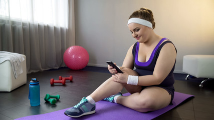 Plump girl delighted to see her weight loss result in smartphone app, fitness