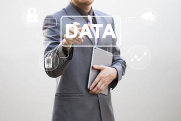 Businessman presses button data internet file on virtual electronic user interface.