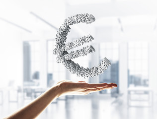 Concept of currency by euro symbol presented in male hand. Mixed