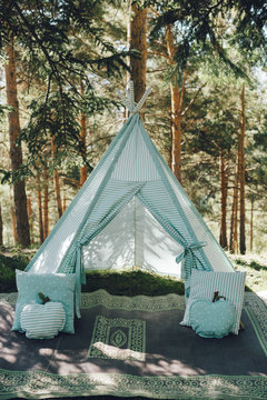 Decorative tent to rest in a pinetree forest