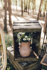 Flower decorations on wedding baskets and jars