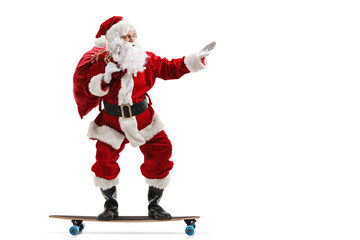 Santa Claus riding a longboard isolated Wall mural
