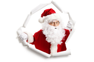 Santa Claus emerging from a paper hole