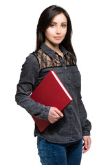 Pretty young student girl with exercise book isolated on white background