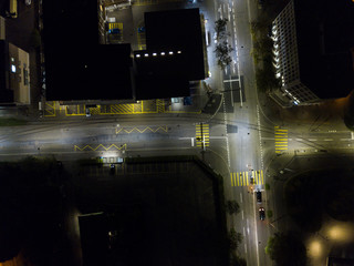 Aerial view of european city in night with bright lights and streets with cars
