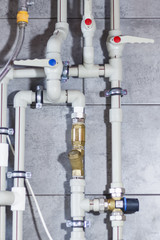 Heating system with plastic pipes, valves and other equipment in the boiler room