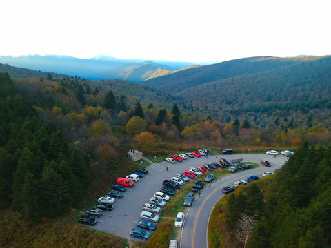 Aerial Drone view of full camp ground parking lot in autumn / fall foliage. Views of the Blue Ridge in the Appalachian Mountains near Asheville, North Carolina. Black Balsam Knob