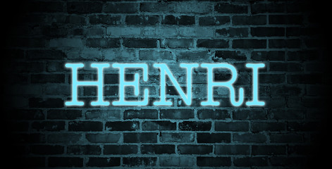 first name Henri in blue neon on brick wall
