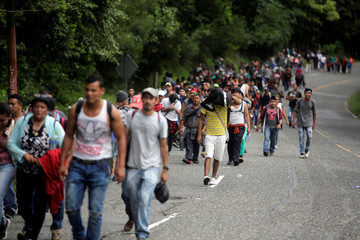 Honduran migrants, part of a caravan trying to reach the U.S., are seen during a new leg of their travel in Esquipulas