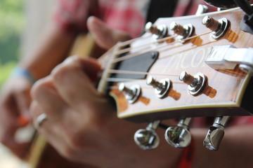 closeup of a man holding guitar keys