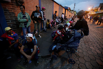 Honduran migrants, part of a caravan trying to reach the U.S., are seen before a new leg of their travel in Esquipulas