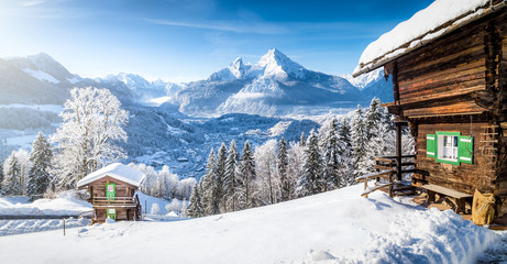 Fototapete - Winter wonderland with mountain chalets in the Alps
