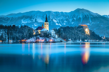Twilight view of Lake Bled with Bled Island and Bled Castle in winter, Slovenia