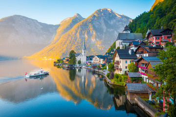 Hallstatt with ship at sunrise, Salzkammergut, Austria