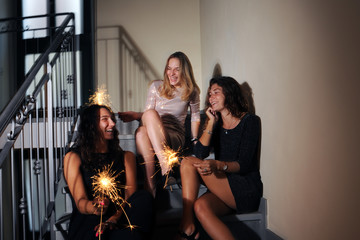 happy girls with sparkles