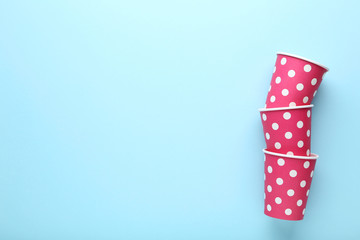 Pink paper cups on blue background
