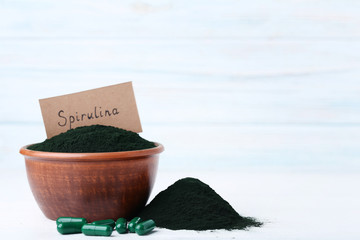 Spirulina powder and capsules with inscription on paper card