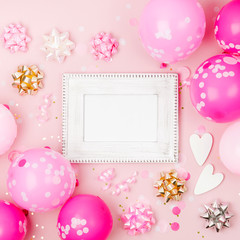 Mockup frame with pink balloons, confetti and decorations. Festive or birthday party concept.. Flat lay, top view.